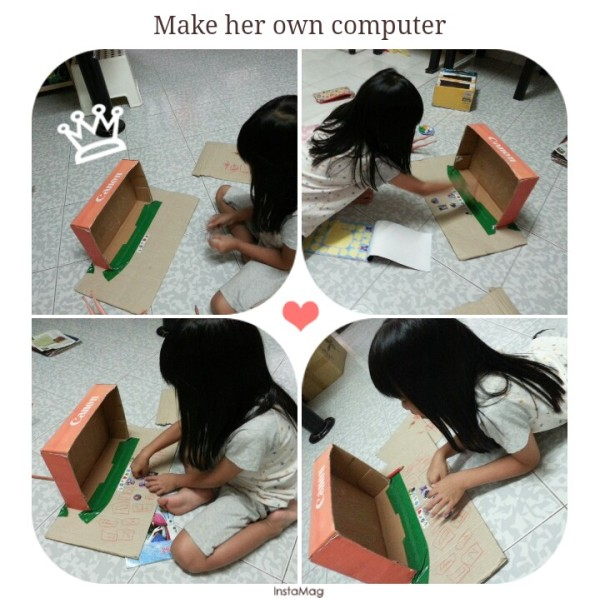 女儿找到一个大的盒子做电脑。。。